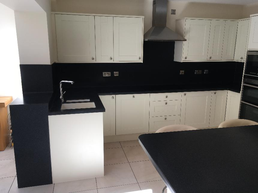 DuPont Corian deep black quartz deep colour technology island breakfast bar drop down slab waterfall end corian avante sinks instant boiling water tap coved splashback solid surface kitchen worktops